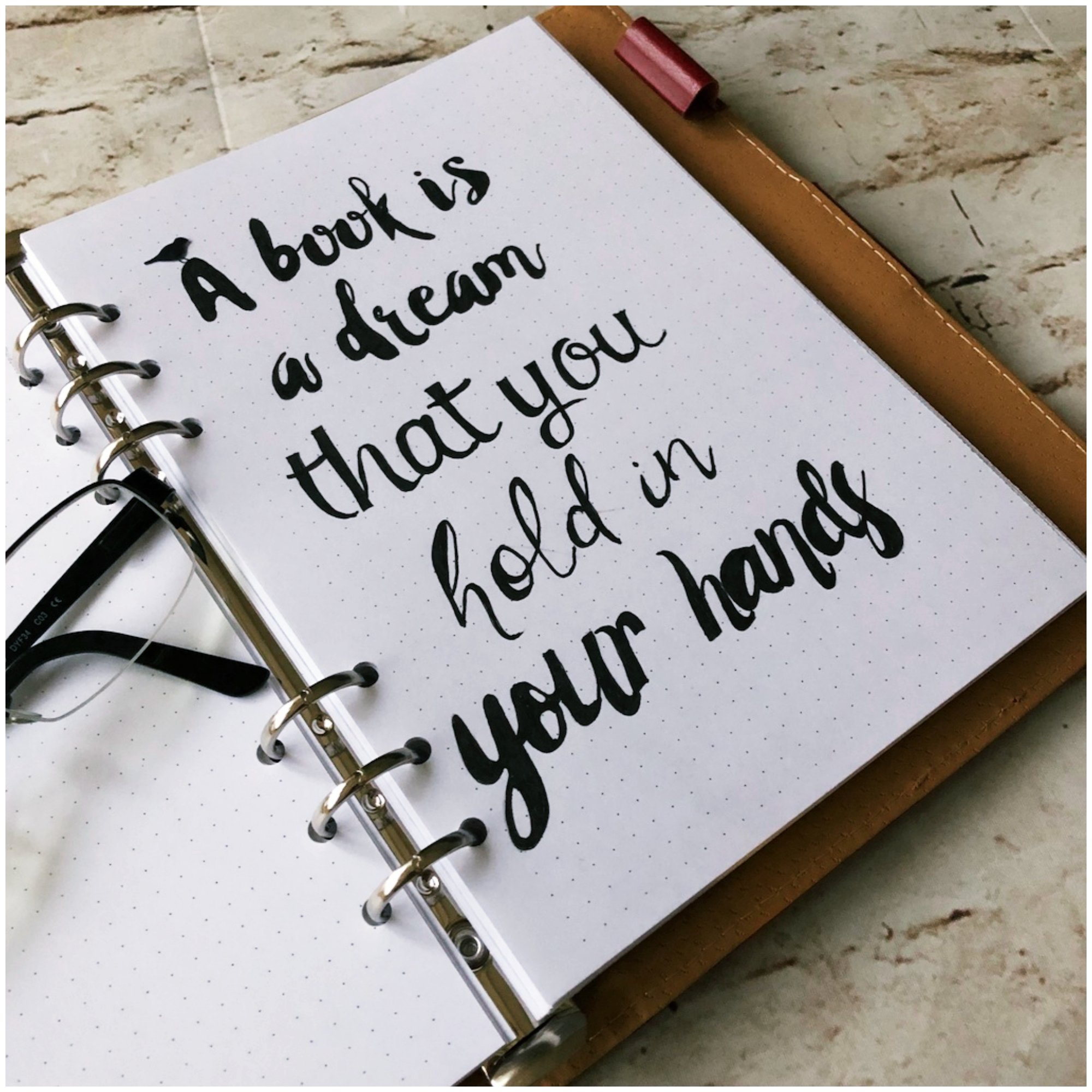 Bullet journal quotes - A book is a dream that you hold in your hands - itstartswithacoffee.com #bulletjournal #quotes #bulletjournaling #lettering